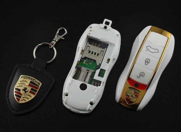 mini t l phone porsche cl de voiture blanc et or destockage grossiste. Black Bedroom Furniture Sets. Home Design Ideas
