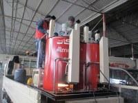 Fondoir de peinture thermoplastique à double cylindres hydrauliques