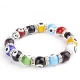 Bracelet bijoux fantaisie compose de billes et d'anneaux en crystaux